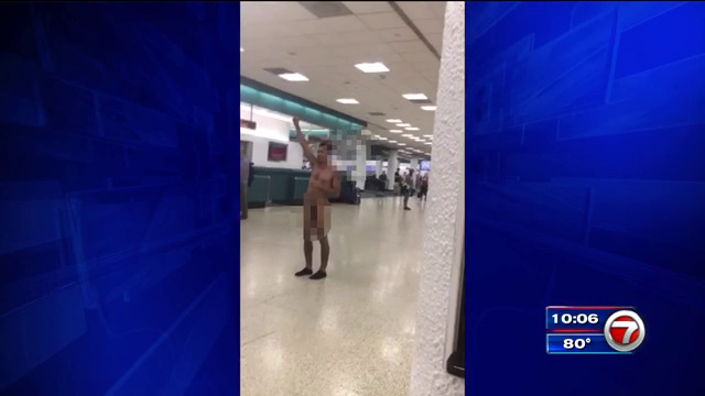 Video shows woman strip off clothes, walk around naked at